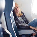 Что с НДФЛ и взносами при возмещении расходов на выбор места в самолете